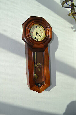 mahogony cased wall clock with passing strike GWO
