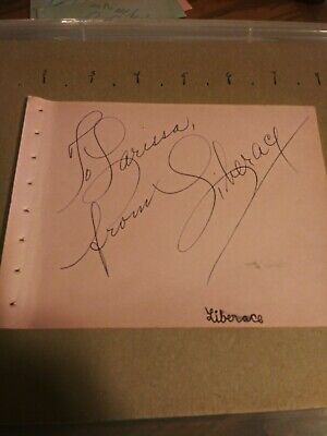 Liberace aotograph. pulled from autograph book. beutiful bold signature just...