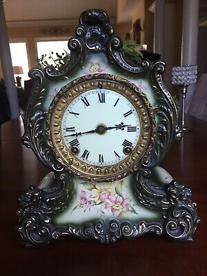antique porcelan clock. Ansonia  mantle clock new york time and strike runs
