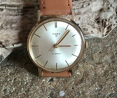 """Vintage """"Timex 21"""" hand wind wristwatch. 21 Jewel movement with gold plate case."""