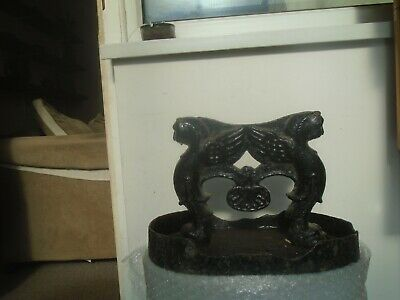 Large heavy antique cast iron door stop with Egyptian revival design  WOW LOOK