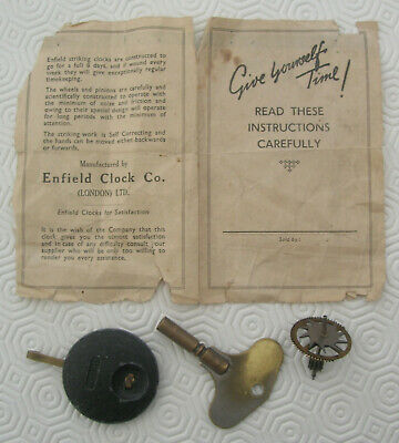 Spare parts, key and instructions for vintage Enfield striking clock