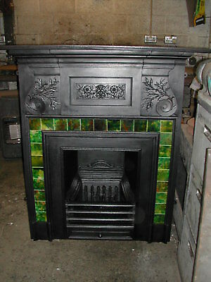 Late Victorian cast iron combination fireplace by Coalbrookdale with green tiles