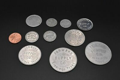 Variety of Farmers Supply Tokens. Giddings, TX