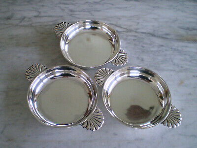 Set of three French sterling silver coasters or dishes.