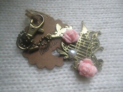 brass bird cage handbag charms/keyring with butterflies and pink resin flowers