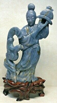 Chinese Carved Jade Or Blue Stone Figure Of An Immortal With Wood Stand
