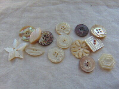 Fourteen Mother of Pearl Buttons Carved Shapes