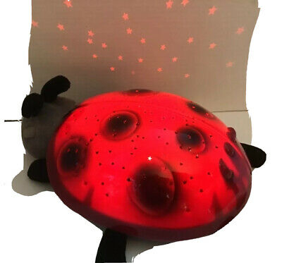 Red Cloud B Twilight Ladybug projects red green and blue stars