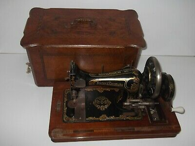 Beautiful Antique Frister and Rossmann Handcrank Sewing machine with wooden case