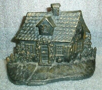 old black painted cast iron cottage house door stop