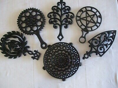Lot of 6 Griswold Cast Iron Trivets-Old Lace #1739, Star #1740, 1730, 1726, 1902