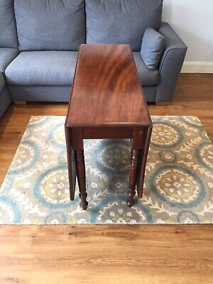 Antique Victorian mahogany drop leaf dining table