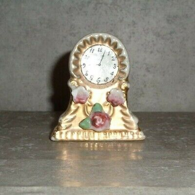 Antique 2 Inch Tall Porcelain Gold Painted Clock Figurine (Japan) **