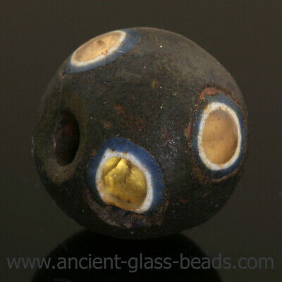 Ancient glass beads: Extremely rare genuine Roman glass bead with gold-foil eyes