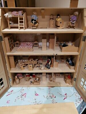 Large 4 storey wooden dolls house with furniture, wooden people & Accessories
