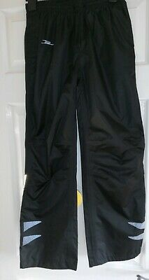 Unisex BNWT Black Waterproof Trousers. Elastic Drawstring Waist. Velcro Pockets