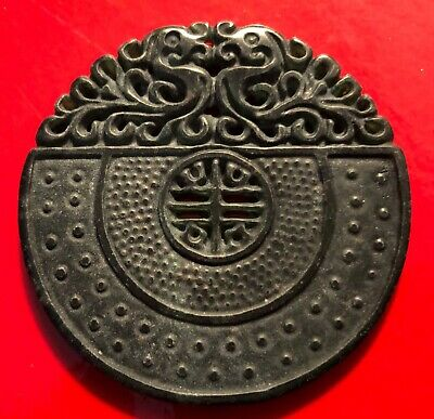 Antique Chinese carved black stone round pendant amulet with twin dragons.