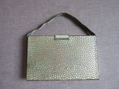 Vintage minaudière compact bag purse with powder contents and small glass bottle