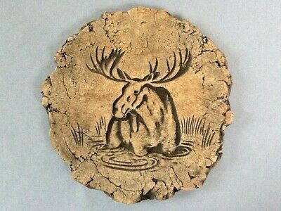 A Decorative Ceramic Engraved Moose Wall Hanging