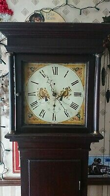 antique grandfather clock keeps good time and in full working order