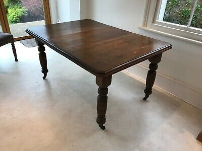 Nice Antique Victorian Mahogany extending dining table, carved legs, castors.