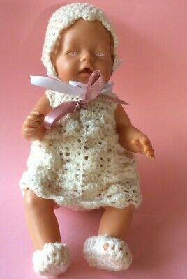 Zapf Creations Original Baby Born Doll with Pink eyes / crochet outfit