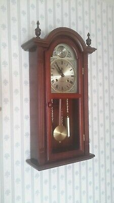 31 Day Mechanical Chiming Wall Clock. Approx size 2ft x 1ft . Perfect time.