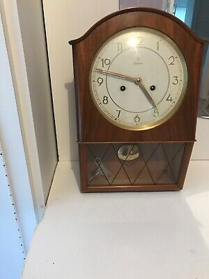 Vintage Junghams wall clock.     Germany