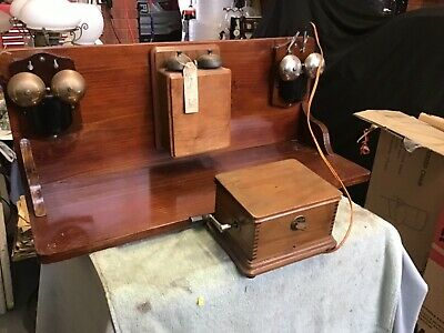 Vintage Telephone, magnetto and three bell set displays on mount