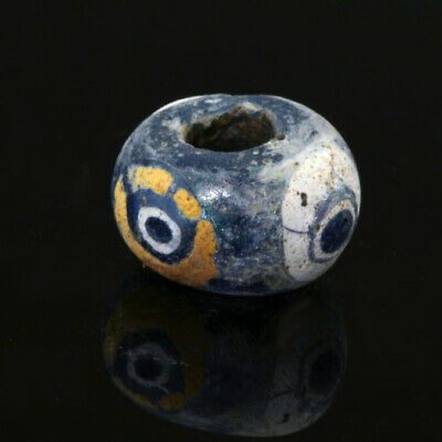 Ancient glass beads: genuine Hellenistic iridescent glass bead with mosaic eyes