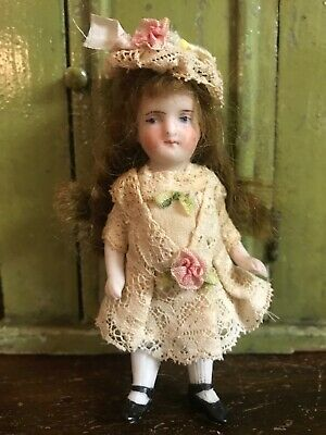 darling little antique bisque dollhouse doll