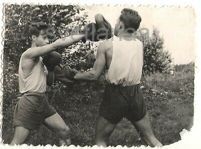 Boxing Fight Muscular athletes Sport Jock Two young men guy trunks vintage Photo