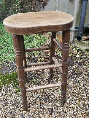 Vintage wooden bar stool, lots of character, good and solid