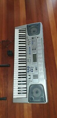 Casio CTK-591 Full-Size Key Piano Electronic Keyboard with Power Adapter & Stand