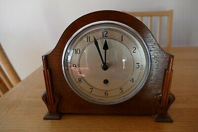 Upcycled vintage wooden mantle clock case with battery quartz movement.