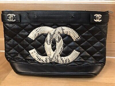 Chanel Black Leather Handbag Authentic Snake Logo Needs Repair Sold As Is.