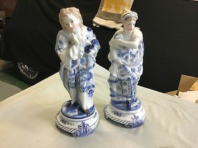 Porcelain Pair of blue white figures with gold trim