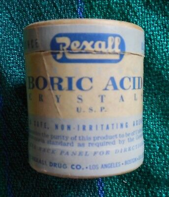 Vintage Rexall Boric Acid Crystals paper container with some crystals present