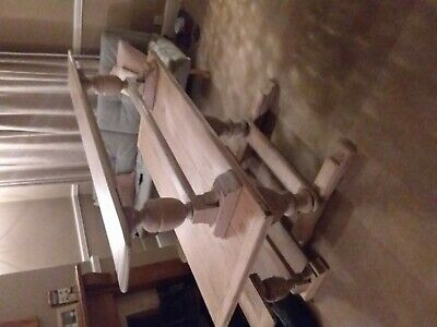 Solid oak antique dining table with two matching bench seats.