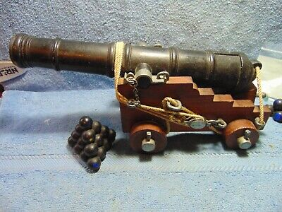 """Toy Cannon, 10"""" cast iron Barrel, 6 1/2"""" wood platform with 4 wood wheels."""