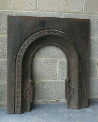 Cast iron fireplace surround with arched aperture Art Deco