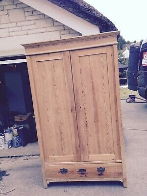 Antique double Pine Wardrobe with a large drawers.