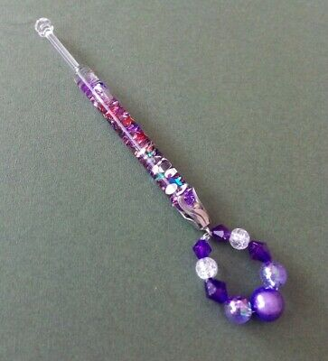Clear Glass Lace Bobbin.With Purple, Red&Green Fragments inside Shank. Spangles.