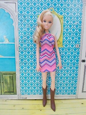 Pretty faced Barbie doll with great condition curly blonde hair in pony tail