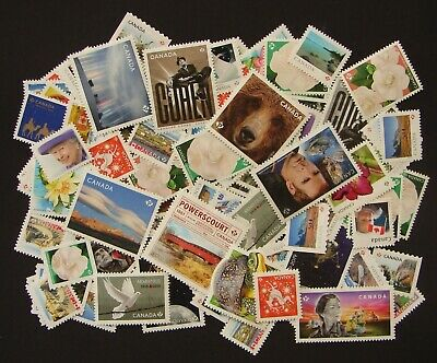 100 P Stamps with Commemoratives - Uncancelled Postage - No Gum - Off paper