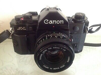 Vintage 35mm Canon A1 camera with case, strap & instruction booklet