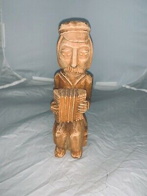 polished wooden carved accordion player