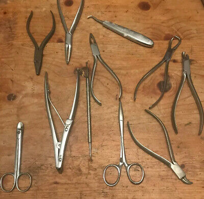 A Selection Of Dental Pliers And Various Tools