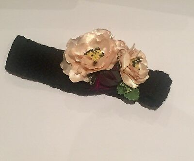 Classic hand knitted headband with flowers